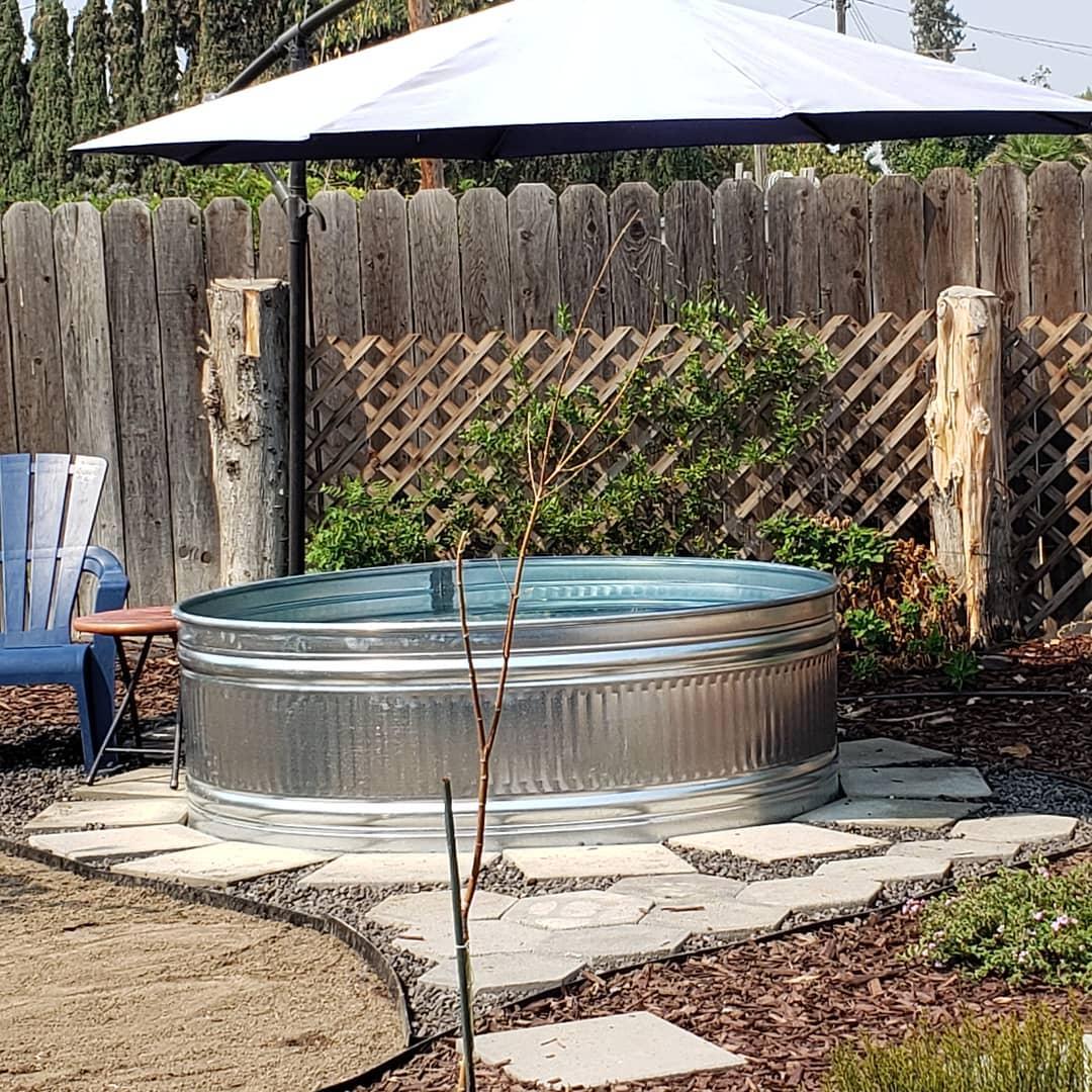 oval-stock-tank-pool-ideas-garretfontes