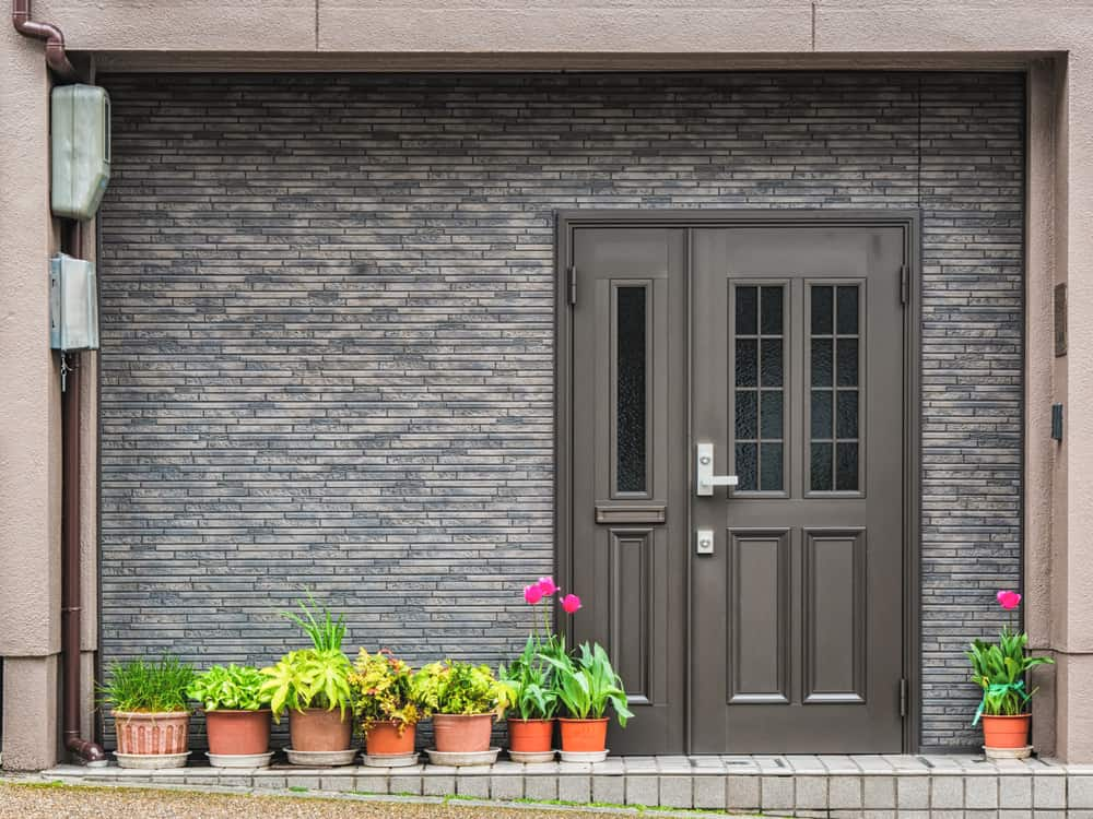 Gray,Front,Door,With,Small,Square,Decorative,Windows,And,Flower