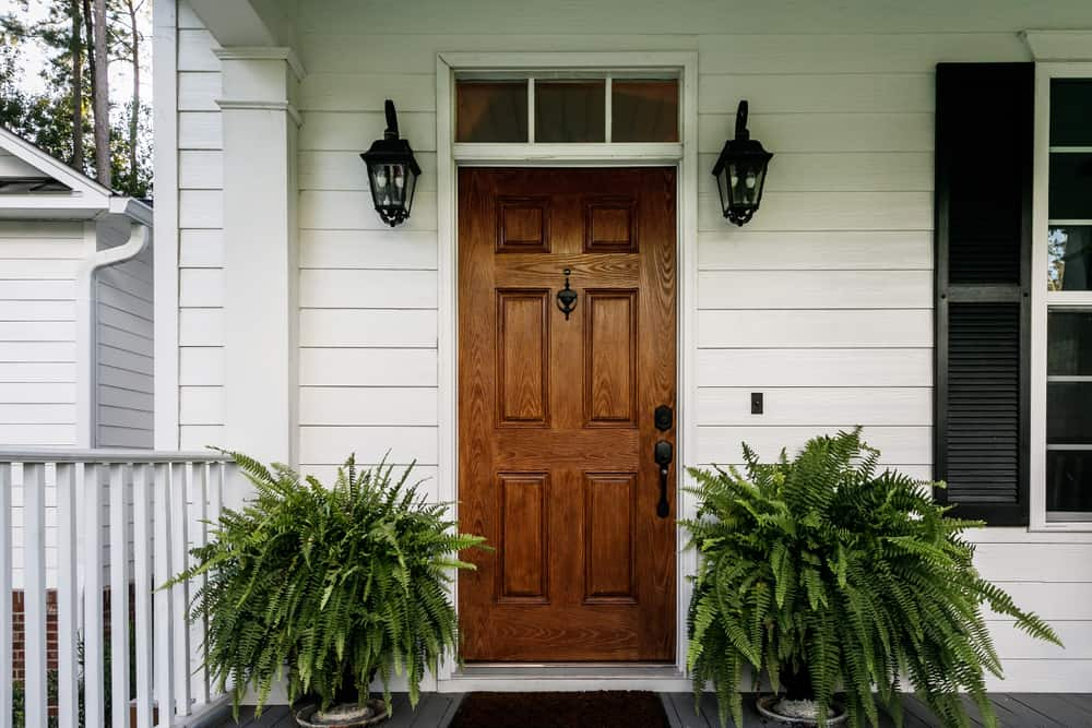 Brown,Wood,Front,Door,Of,A,White,Siding,Southern,House