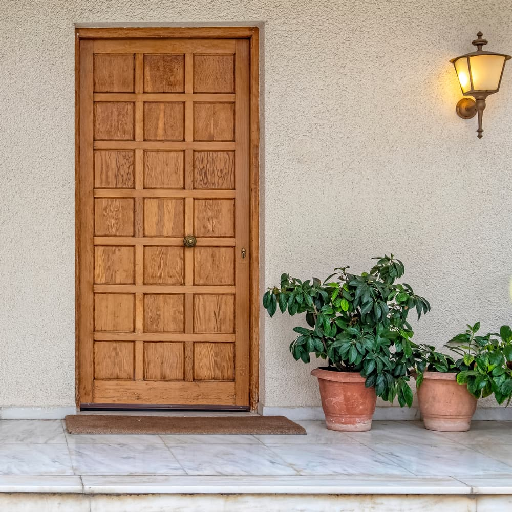 Elegant,House,Front,External,Natural,Wood,Door,And,Flowerpots,,Athens