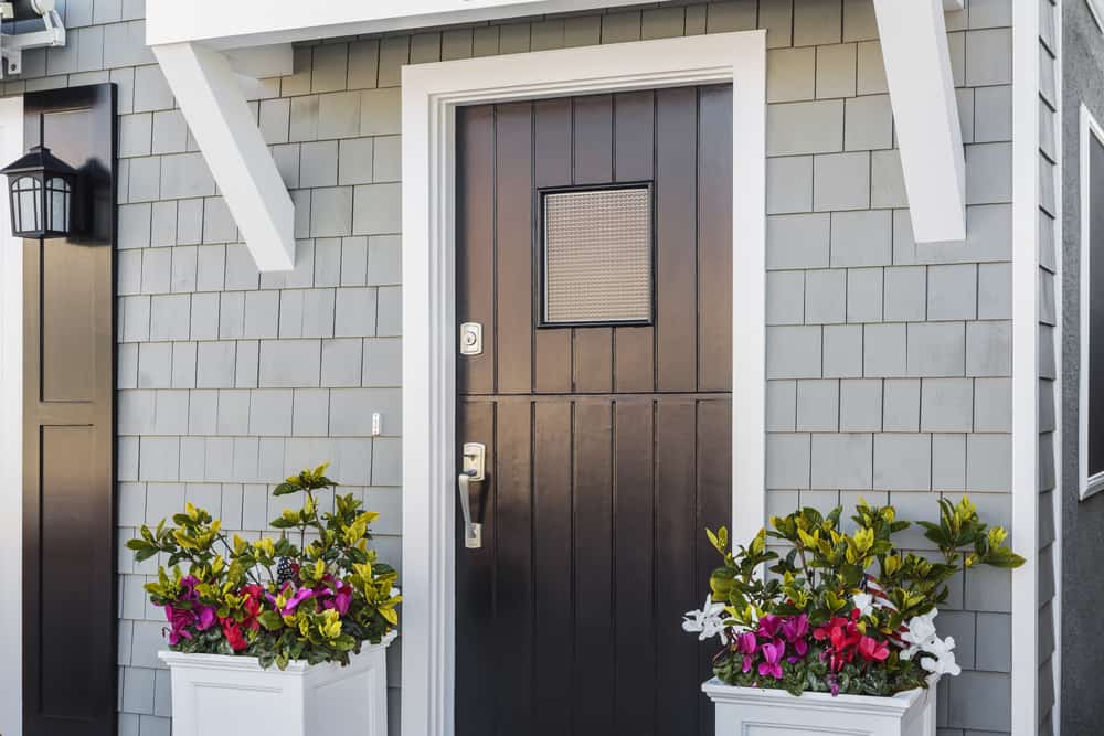 Angled,View,Of,Glossy,Black,Front,Door,To,A,Family