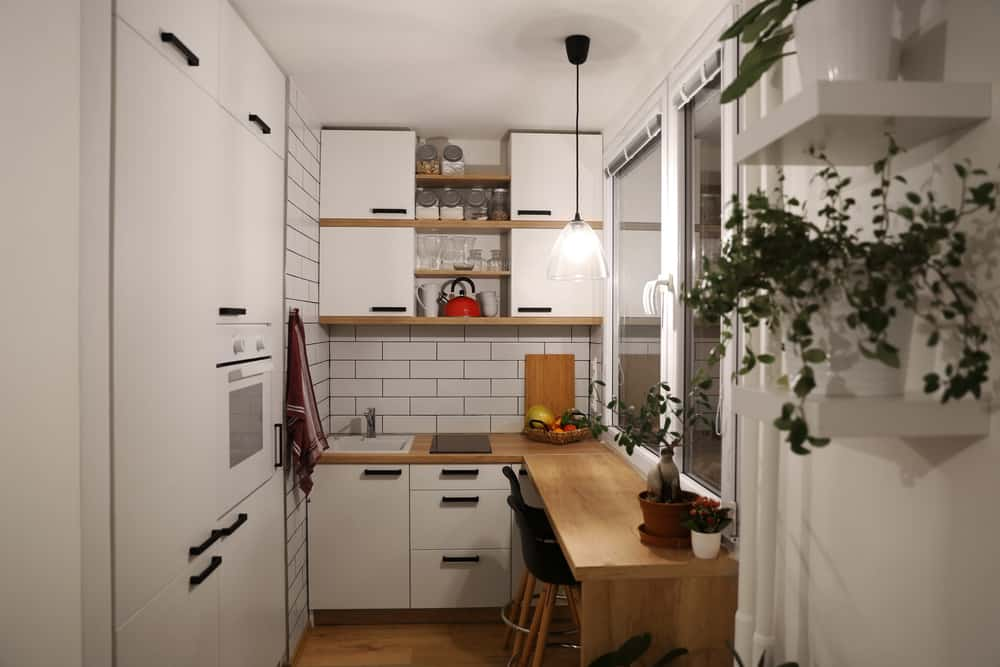 White,Kitchen,With,Red,Components,,Cosy,Tine,House