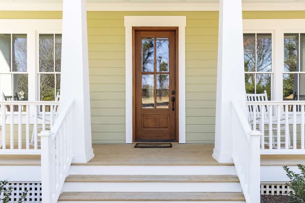 Front,Door,,Front,View,An,Inviting,House,With,A,Porch