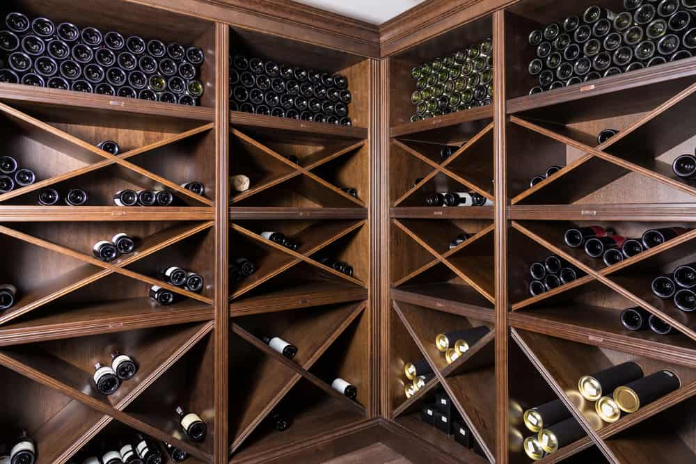 Wine,Cellar,With,Bottles,On,Wooden,Shelves