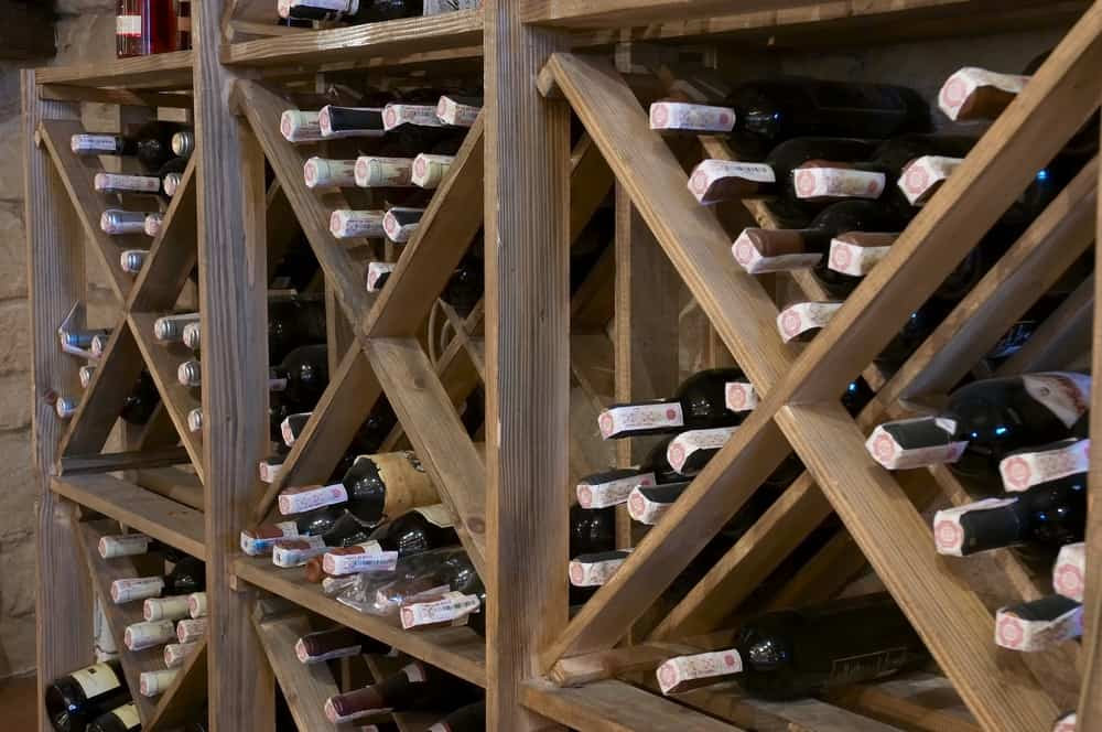 Wine,Bottles,Laying,In,Wooden,Rack